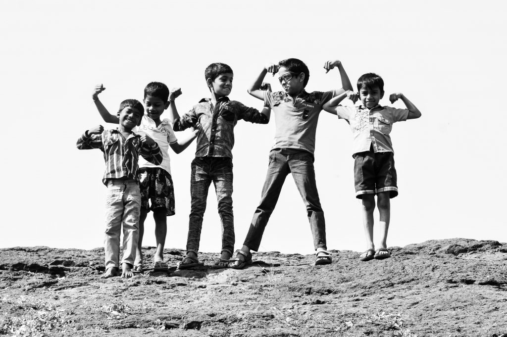 grayscale photography of five boys